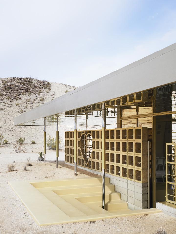 Exterior View Of The Entrance With Gold Painted Concrete Blocks. Acido  Dorado, Joshua Tree, United States. Architect: Robert Stone Design, 2009.