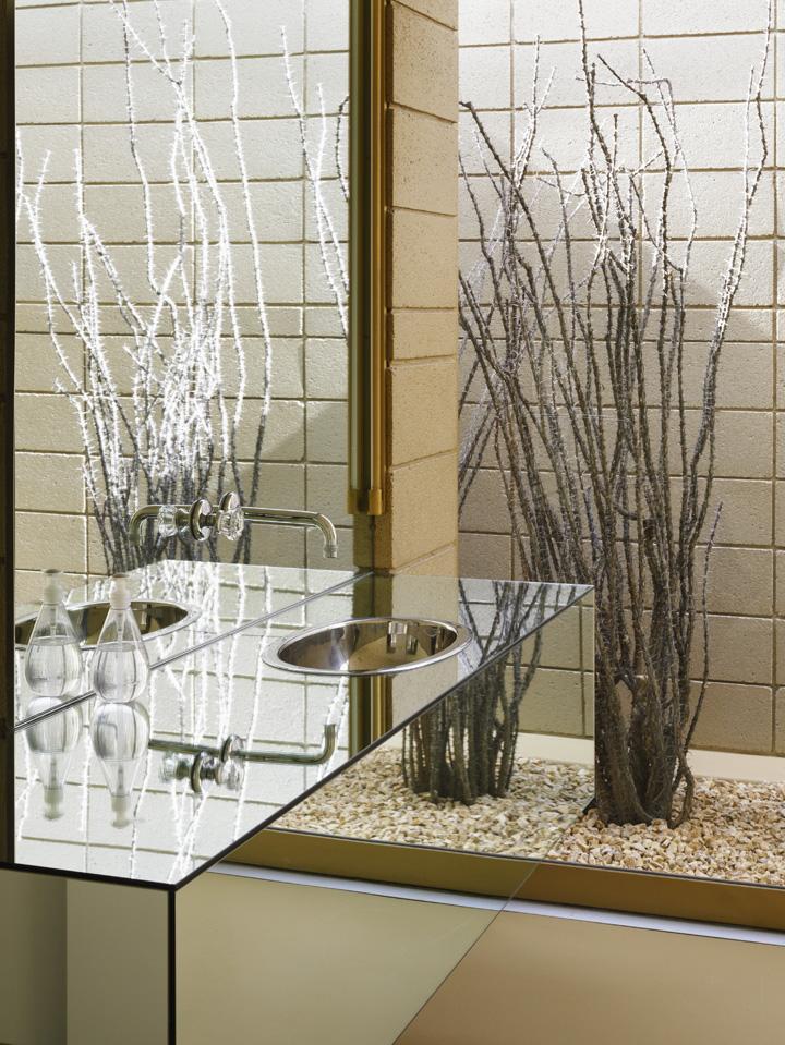 Floating Mirrored Sink Vanity In The Bedroom. Acido Dorado, Joshua Tree,  United States. Architect: Robert Stone Design, 2009.